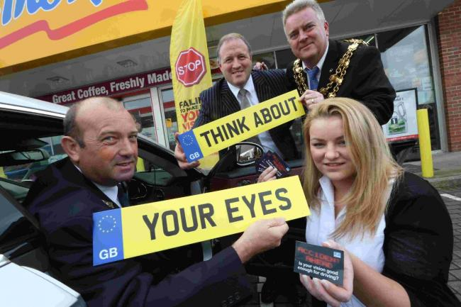 Cllr Phil Eades and his chauffeur, Gary Richards, with Classic Eyes' clinical assistant Amy Cook and Brian Halliday, of Essilor