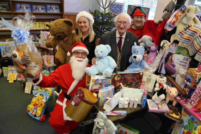 Phil Carey and Daily Echo staff with donations to the toy appeal