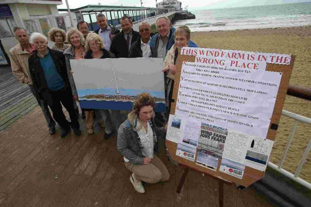 PROPOSALS: Wind farm protestors gather outside the pier on Bournemouth Beach