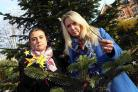 ANGRY: Lucy Cooper and Maria Tidy with the tree attacked by vandals