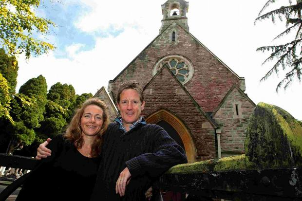 HELPING: Reverend Charlie Boyle with wife Sarah