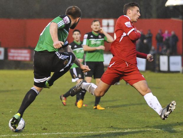 LOAN STAR: Baily Cargill in action for Welling (red kit)