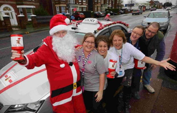 Bournemouth Echo: GOOD CAUSE: Staff from the children's unit at Poole Hospital with  Paul Owen