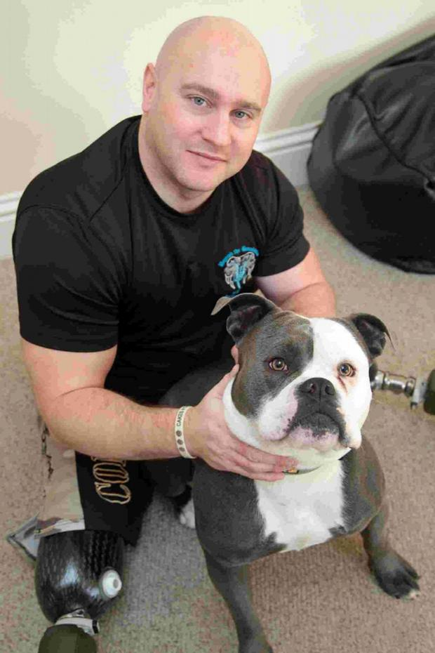 Bournemouth Echo: CHARITY: Soldier Jim Wilson with his dog Vallon