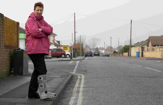 'traumatised': Maggie Russell at the spot where she was hit by a car at Rossmore Road leaving her with several broken bones in her foot