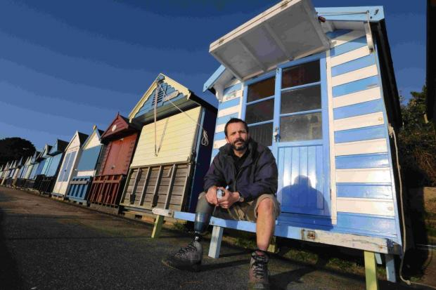 'NO ENFORCEMENT': John Sandford-Hart with his striped beach hut at  Avon beach
