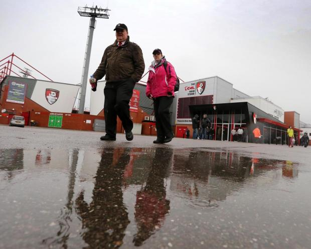 MATCH POSTPONED: Two supporters leave Dean Court yesterday