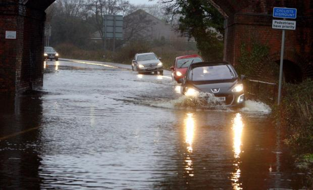 'Don't ignore road closed signs' warning after motorists drive through floodwater
