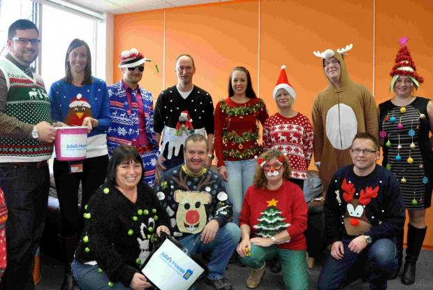 Staff at Health-on-Line in Bournemouth raising money for Julia's House through an outrageous jumper competition