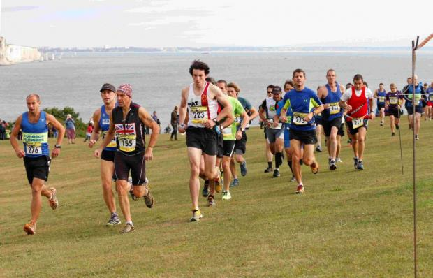 OFF ON THE RIGHT FOOT: Runners set off from Swanage Downs at the beginning of the second Purbeck Marathon