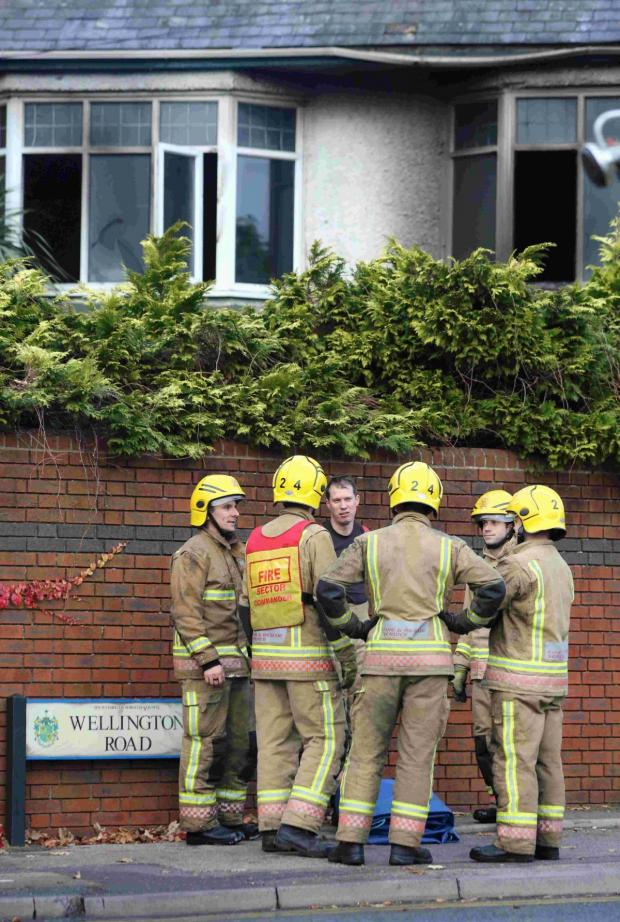 Bournemouth Echo: HAZARD: Emergency services at the scene of a fire at a derelict house in Wellington Road