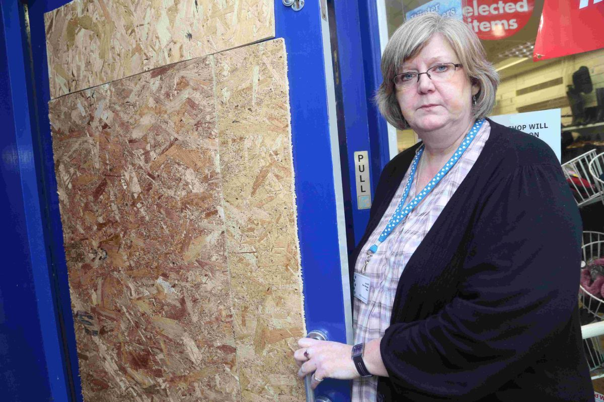 RUINED: Jane Hill with the smashed front door
