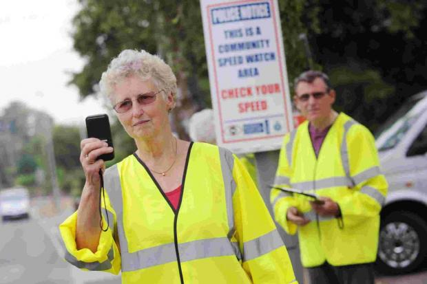 Bournemouth Echo: GUNNING FOR SPEEDING MOTORISTS: Volunteers carrying out speed checks