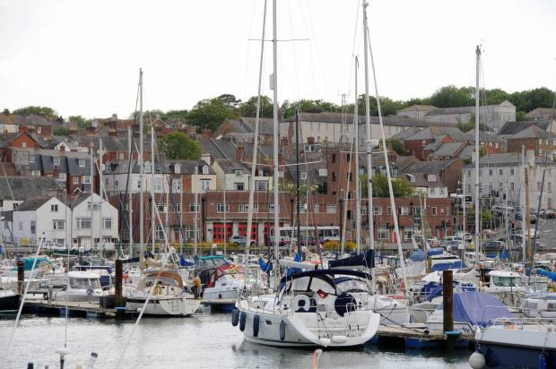 Teenager dies after falling into Weymouth harbour