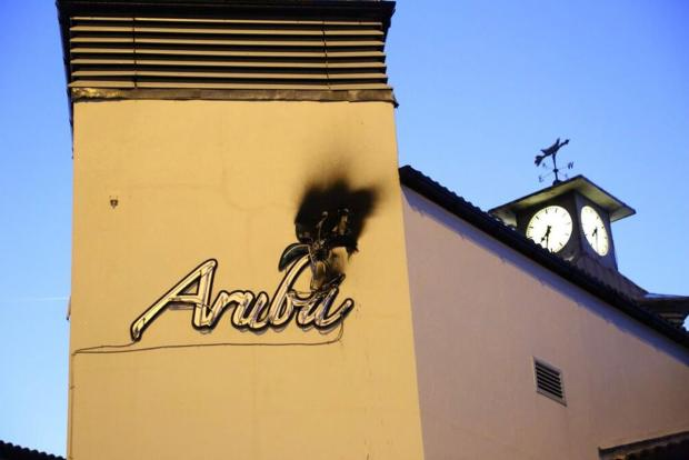 Fire crews called to neon sign blaze at Aruba bar