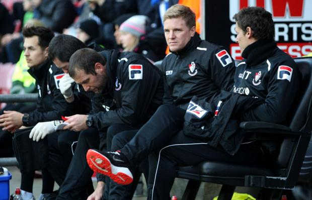 MANAGEMENT TEAM: Eddie Howe and his backroom staff at Wigan yesterday