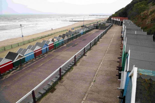 Beach huts cordoned off after woman taken ill