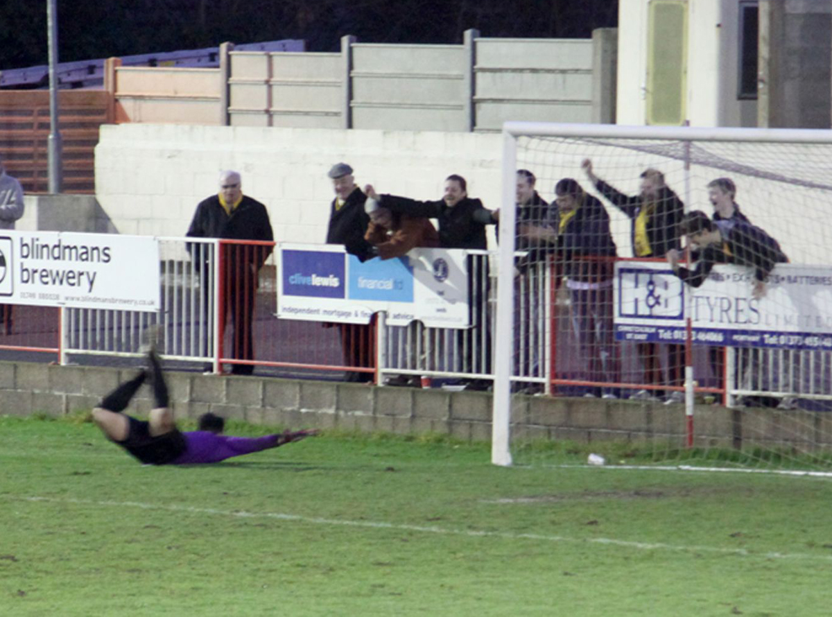 WINNING DIVE: Nic Jones celebrates a rare victory with Bashley fans