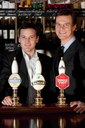 CHEERS: Hall and Woodhouse managing director Anthony Woodhouse, left, and director Matt Kearsey