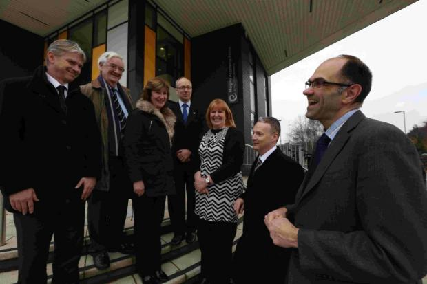 LEAKY: Magna Academy principal Richard Tutt, far right, showed council officers around the new school building