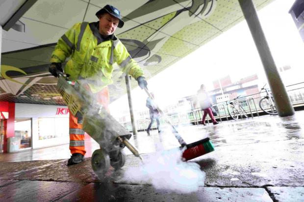 STEAMED UP: Cleansing operative Mike Lockhart using the new Gumwand machine at Poole bus station to remove chewing gum from the pavement
