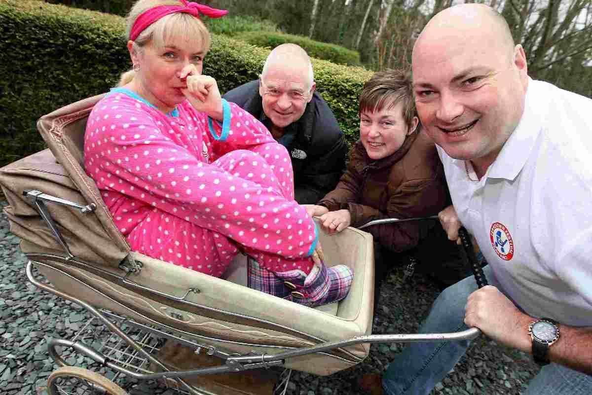 DUMMY RUN: Promoting this year's pram race, from left, are Billie Brown, Pete Thornton, Cllr Liz Norman and Cllr Tony Brown