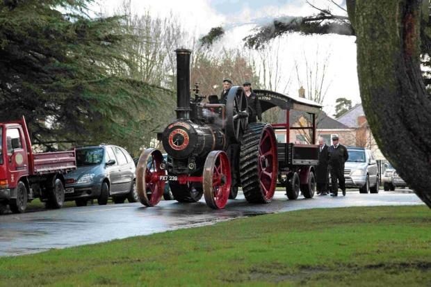 TRIBUTE: A steam traction engine carries the coffin of David 'Roy' Loader, inset, into Bournemouth Crematorium