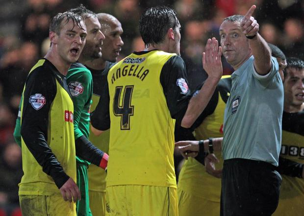 Bournemouth Echo: IT WASN'T ME: Gabriele Angella is sent off by referee Carl Boyeson (Picture: Sally Adams)