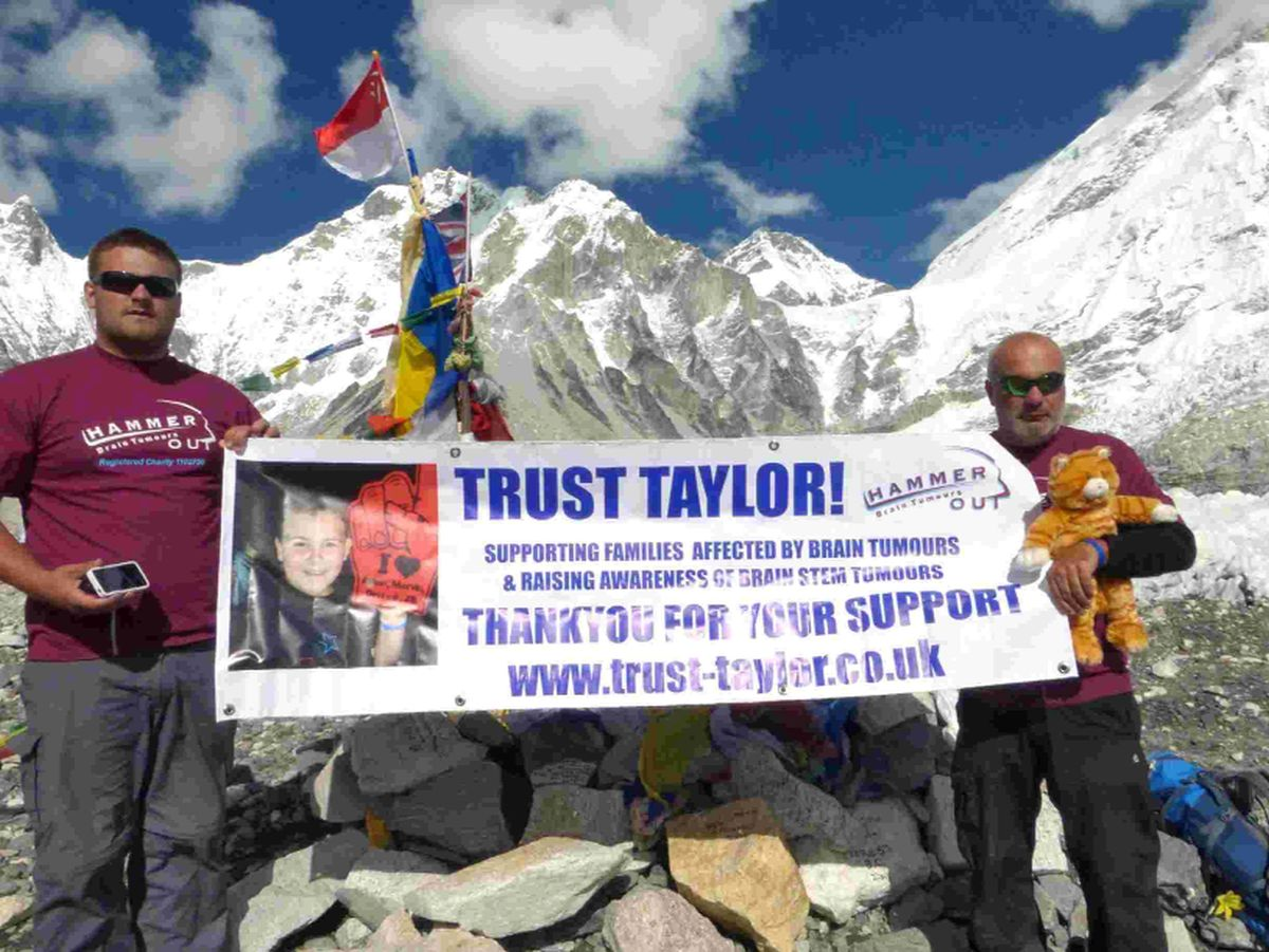 Father and son raise £5k by walking to Mount Everest base camp in memory of relative Taylor Fish