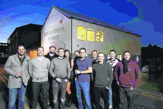 The teams from Fireworx and IADigital outside the refurbished building at Bournemouth's Triangle