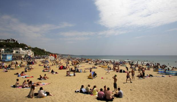 Bournemouth Echo: South coast residents enjoying the sunshine at Bournemouth beach last year and boosting their immunity to cardiovascular problems in the process.