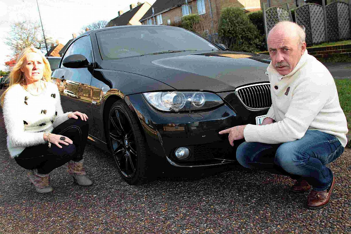 SMASHED UP: Andrew Thomas and his wife Andrea are angry at the damage caused to their BMW in ASDA