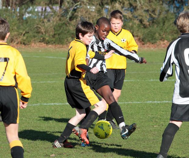 COUNTY CUP ACTION: Branksome under-12s v Wimborne (stripes)