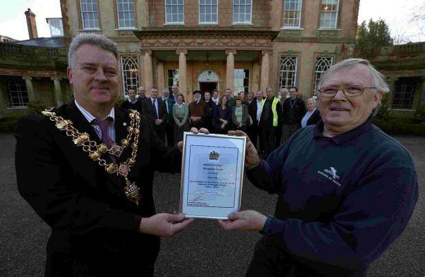 THANKS: The Mayor of Poole Cllr Philp Eades presents a recognition award to Alan Cook