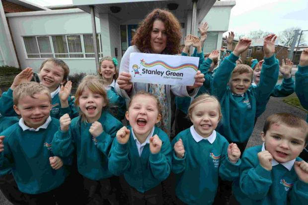 FIRST: Stanley Green head teacher Angela Malanczuk with pupils