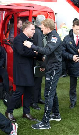 WARM RECEPTION: Eddie Howe welcomes Liverpool boss Brendan Rodgers to AFC Bournemouth