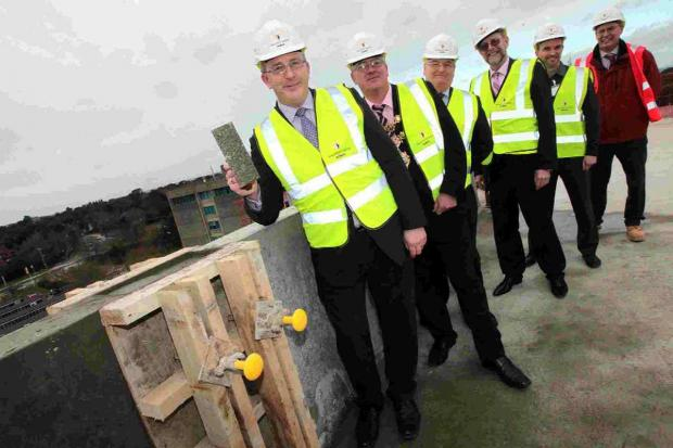 CEREMONY: Pictured from left, BU Vice Chancellor Professor John Vinney, Mayor of Poole Councillor Phil Eades, Graham Beards, Professor John Fletcher, Paul Moisan and Andy Jones from Willmott Dixon