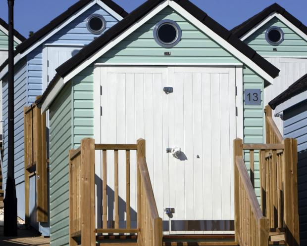 The current beach huts at Alum Chine