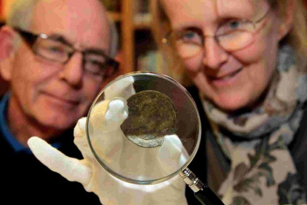 Centenary: Chris Cockwell and Poole Museum curator Sue Beckett examine Chris's medal