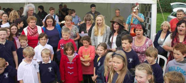 IN GOOD VOICE: Youngsters with Brian May at an event last year