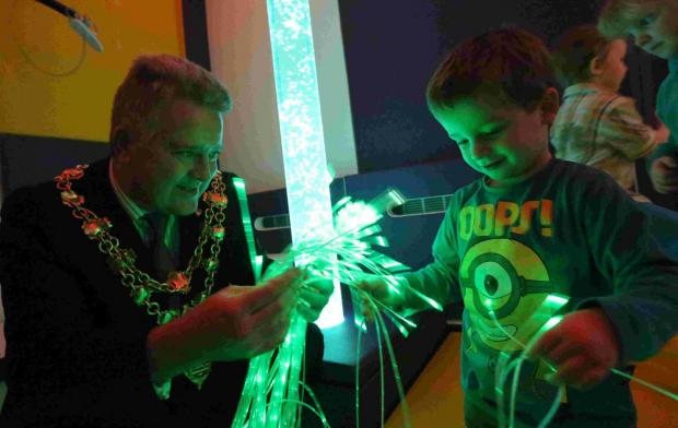 SEE THE LIGHT:  Poole Mayor Phil Eades with Gino Everett, two, in the new sensory room