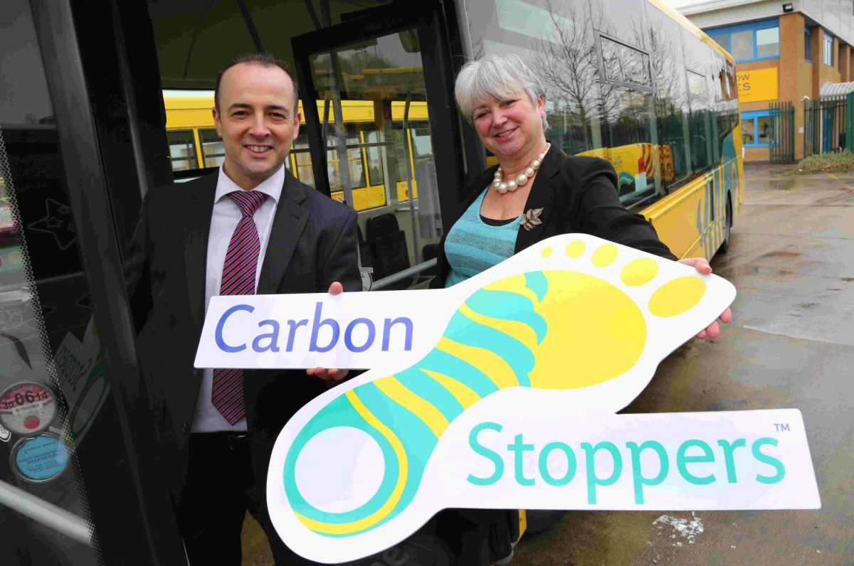 DRIVING SEAT: Daily Echo editor Toby Granville with Jenni Wilkinson from Yellow Buses