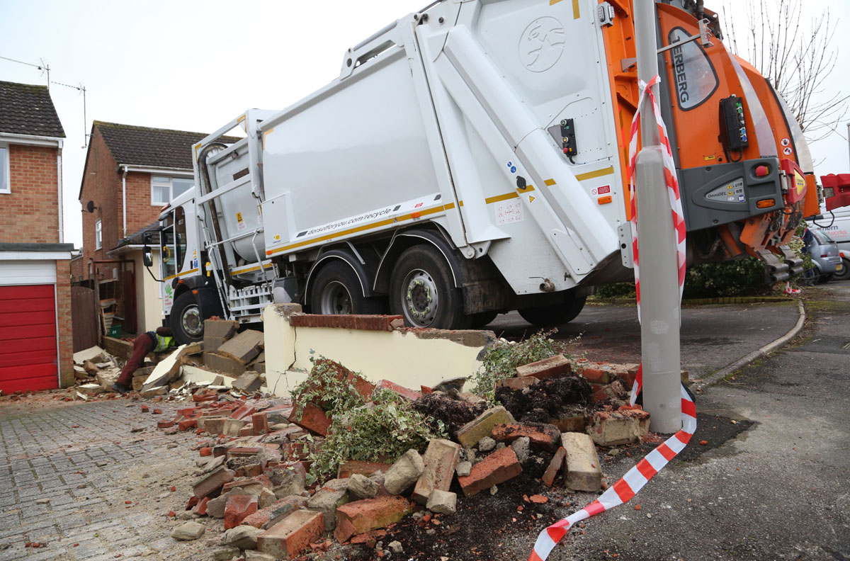 UPDATED: Lucky escape for homeowners after refuse truck crashes into driveways