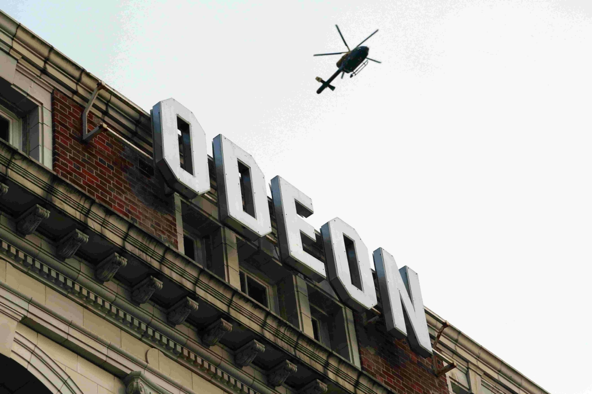 DRAMA: The helicopter hovers over the scene around Odeon in Westover Road.