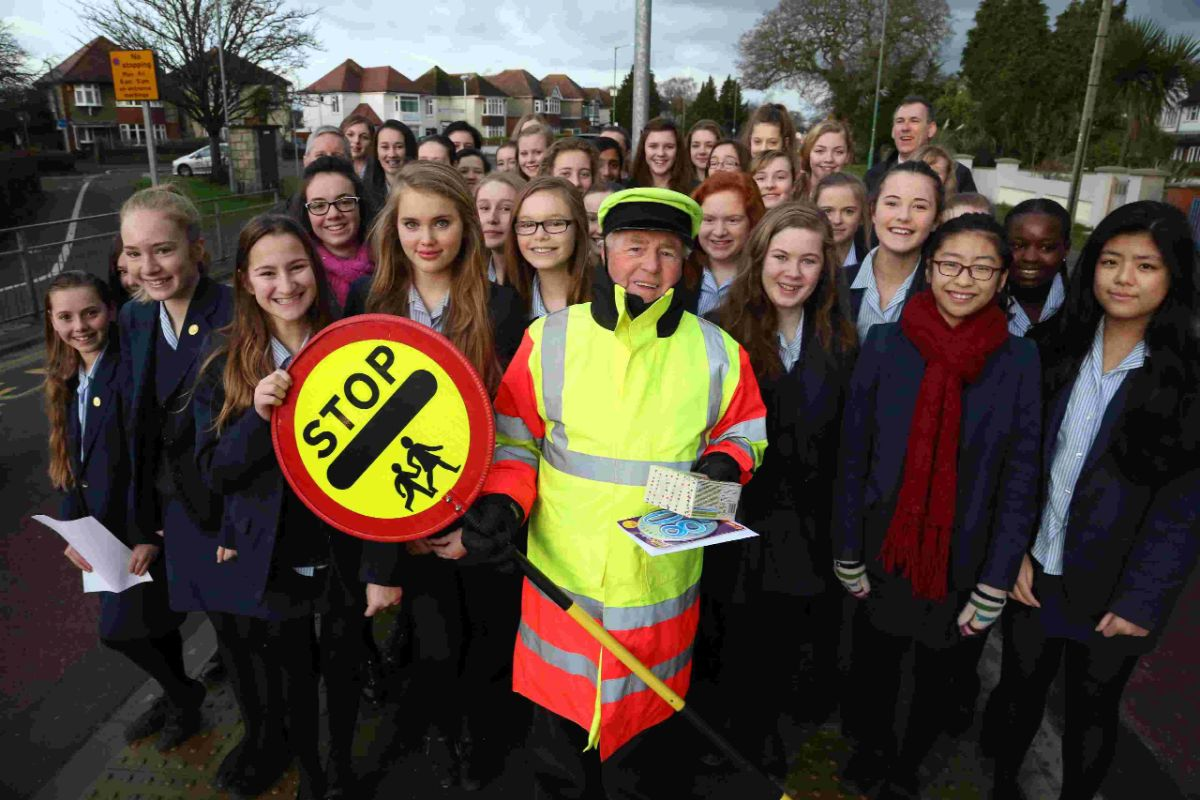 BIRTHDAY BOY: Lollipop man Wilf is serenaded by Bournemouth  School girls