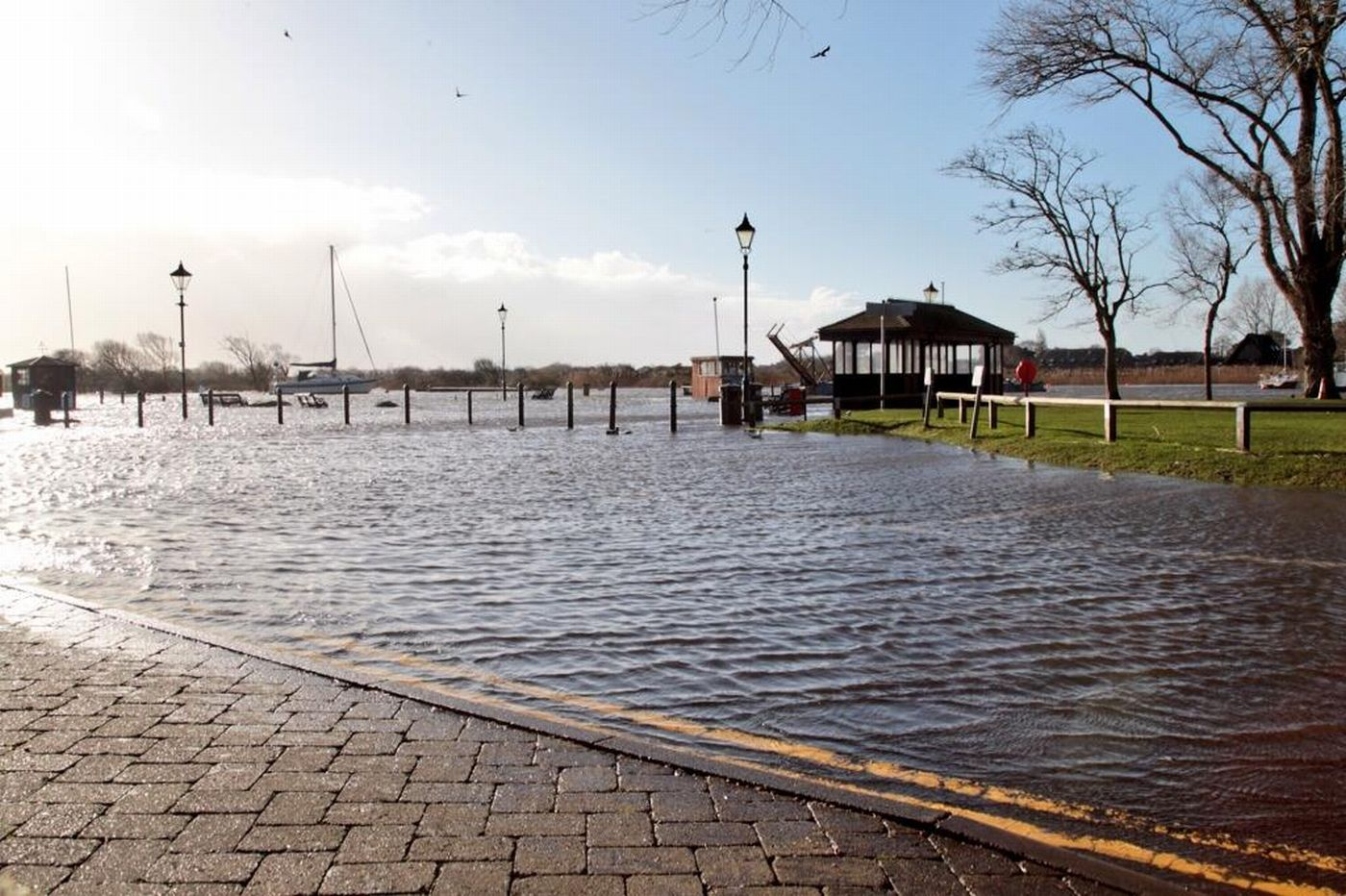 UPDATE: Roads flooded and people told to stay away from coast as heavy rain and strong winds sweep across Dorset