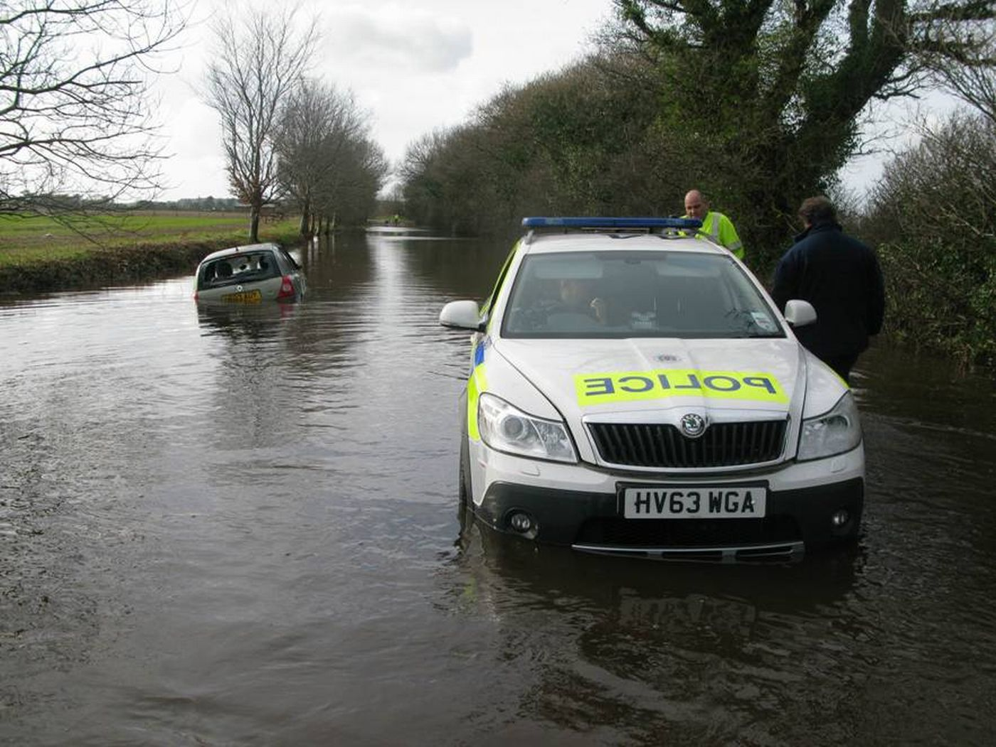 UPDATE WITH VIDEO: Police car stuck in floodwater as area braces itself for more rain