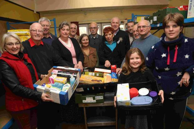 MUCKING IN: Members of Bournemouth North Rotary Club help out alongside church volunteers