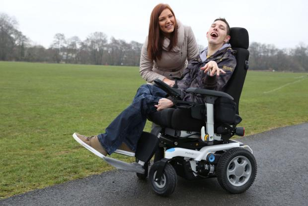 ELECTRIC: Scott Bunter and his sister Charlotte with his wheelchair