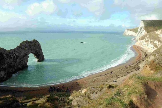 Man falls 30ft down cliff at Durdle Door and lands on ledge